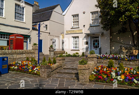 Devizes, Wiltshire, England, UK. March 2019. Funeral parlour with spring flowers the town centre. - Stock Photo
