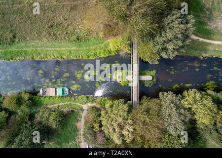 Aerial image of a bridge and a water inlet in the river Niers in West Germany - Stock Photo