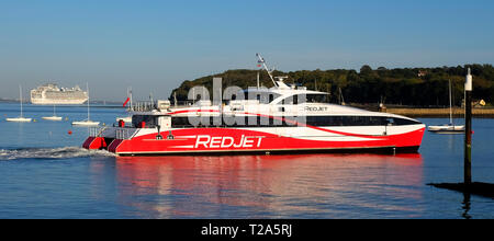 Pollution,cruise,liner,Red Jet,Funnel,fast,passenger,ferry,entering,Cowes,Isle of Wight,England,UK, - Stock Photo