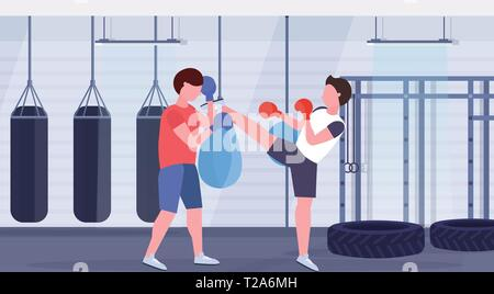 two boxers training kick boxing exercises fighters in gloves practicing together modern fight club with punching bags healthy lifestyle concept flat - Stock Photo