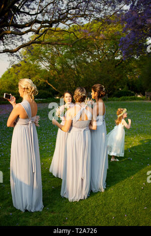 Bridesmaids at wedding at St Andrew's School for Girls - Stock Photo