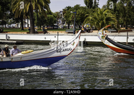 Aveiro, Portugal - Sep 4rd 2016: Beautiful colorful boats called moliceiros on the canal in portuguese Aveiro. These amazing gondola boats are used fo - Stock Photo