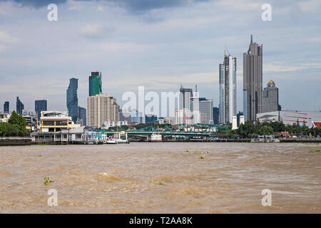 Modern skyscrapers seen from the Chao Phraya river, Bangkok, Thailand. - Stock Photo