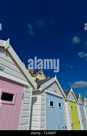 UK .Brightly coloured Beach Huts against a deep blue sky with light white clouds on the promenade of Lyme Regis in Dorset.Picture Credit Robert Timone - Stock Photo