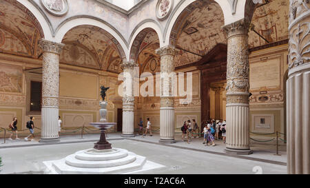 Florence, Italy - August 8, 2018: People in the courtyard of Palazzo Vecchio. The historical center of Florence is listed as UNESCO World Heritage sin - Stock Photo