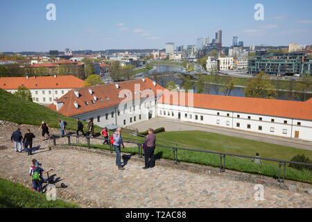 Vilnius, Lithuania - May 6, 2017: People on the road to the Gediminas Hill against the cityscape. The hill and located here Upper Castle is one of mus - Stock Photo