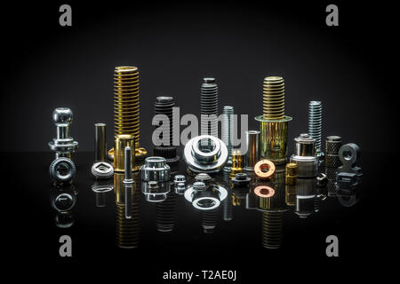 A neat arrangement of assorted Nuts, bolts and fasteners - Stock Photo
