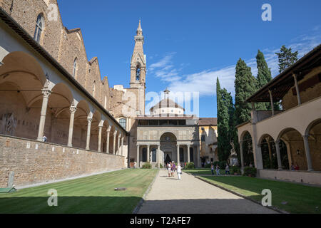 Florence, Italy - June 24, 2018: Panoramic view of inner garden of Basilica di Santa Croce (Basilica of the Holy Cross) is Franciscan church in Floren - Stock Photo