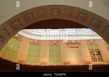 HAARLEM, NETHERLANDS - MARCH 24, 2019: The Oval room (dated from 1784) inside Teylers Museum (art, natural history and science) with wooden and ornate - Stock Photo