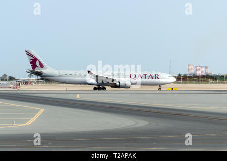 Doha, Qatar, 2018-05-01:  Airplane by Qatar Airlines taxiing to the runway. Planes at airport concept. Passenger plane arrives on taxiway.  Side view. - Stock Photo