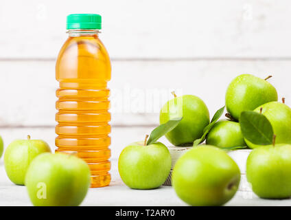 Bottle of fresh organic apple juice with granny smith and british bramley apples in box on wooden background. Space for text - Stock Photo