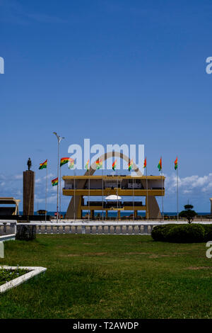 ACCRA,GHANA - APRIL 11 2018: Looking towards statue, Independence Arch and flags of Ghana in Accra's Independence Square, site of Independence Day par - Stock Photo