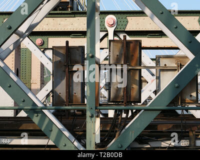 Detail of steel construction and rails of Hungerford Railway Bridge, London, England, UK. - Stock Photo