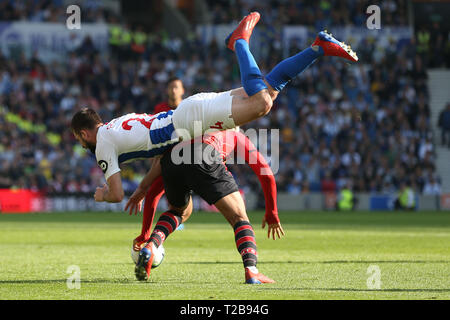 Southampton's Yan Valery tackles Brighton's Davy Propper during the English Premier League match between Brighton Hove Albion and Southampton at the Amex Stadium in Brighton. 30 March  2019 Photo James Boardman / Telephoto Images EDITORIAL USE ONLY. No use with unauthorized audio, video, data, fixture lists, club/league logos or 'live' services. Online in-match use limited to 120 images, no video emulation. No use in betting, games or single club/league/player publications. - Stock Photo