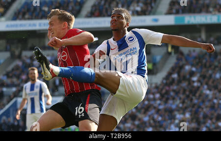 Brighton's Bernardo (R) is challenged by Southampton's James Ward-Prowse during the English Premier League match between Brighton Hove Albion and Southampton at the Amex Stadium in Brighton. 30 March  2019 Photo James Boardman / Telephoto Images EDITORIAL USE ONLY. No use with unauthorized audio, video, data, fixture lists, club/league logos or 'live' services. Online in-match use limited to 120 images, no video emulation. No use in betting, games or single club/league/player publications. - Stock Photo
