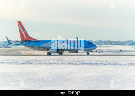 Montreal, Canada- January 20, 2019: Airplane of Sunwing above the Trudeau airport in Canada. - Stock Photo