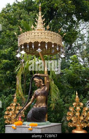 Chiang Mai Thailand, Phra Mae Thorani statue in garden at Wat Pan Ping - Stock Photo