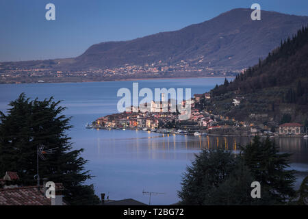 Lake Iseo with the town of Peschiera Maraglio on Monte Isola at down, Lombardy, Italy - Stock Photo