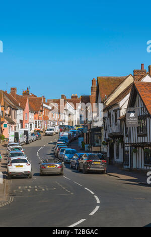 Lavenham Suffolk, view in summer of old buildings and shops lining both sides of the High Street in Lavenham, Babergh district, Suffolk, England, UK. - Stock Photo
