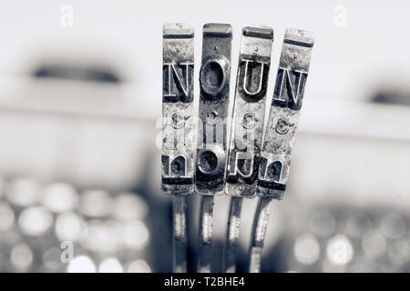 the word NOUN  with old typwriter keys  monochrome - Stock Photo