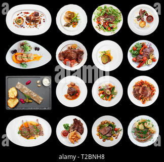 Set of main meat dishes isolated on black background - Stock Photo
