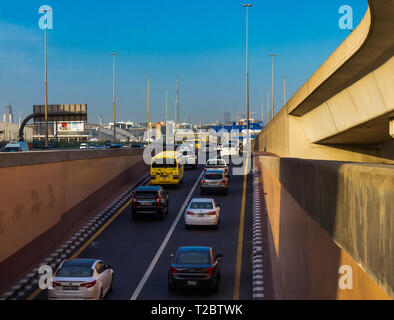 Dubai, United Arab Emirates; 1 April 2019; Flow of vehicles moving out from a tunnel towards downtown. View on Burj Khalifa - the tallest building in - Stock Photo