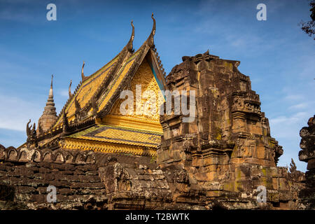 Cambodia, Kampong (Kompong) Cham, Banteay Prei Nokor, ornate roof of central Vihara prayer hall above ancient old stone temple ruins - Stock Photo