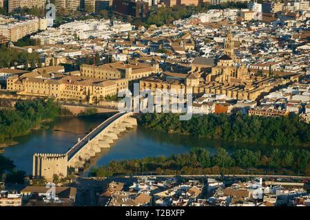 HISTORIC COMPLEX OF MOORISH AND CHRISTIAN BUILDINGS ALONGSIDE THE GUADALQUIVIR RIVER (aerial view). Cordoba, Andalusia, Spain. - Stock Photo