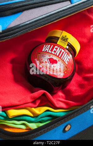 Special edition jar of Valentine Marmite by Unilever, spread the love this Valentines, packed in suitcase ready for holiday - Stock Photo