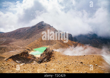 Hikers at Tongariro Alpine Crossing tramping track, one of the most popular day hikes in New Zealand. Track crossing the Tongariro National Park, the  - Stock Photo