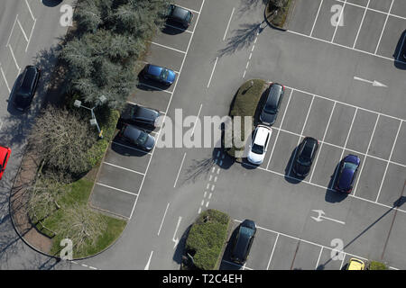 vertical aerial view of cars parked in a car park, UK - Stock Photo