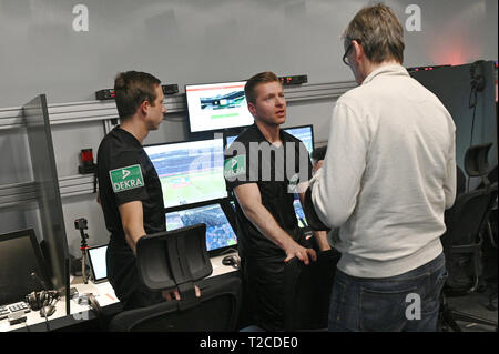 31 March 2019, North Rhine-Westphalia, Köln: Football Bundesliga - video evidence, visit to the Video Assist Center during live football Bundesliga coverage. VA Coach Rainer Werthmann (r) talks to the video assistants Mark Borsch (l) and Tobias Welz (m) during the half-time break. Photo: Henning Kaiser/dpa - Stock Photo