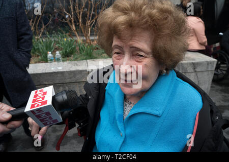 "New York, USA. 31st Mar, 2019. Ray Kaner, 92, who was transported from Lodz, Poland to Auschwitz in August 1944, described her experiences on the plaza in front of the Museum of Jewish Heritage in Battery Park City, Manhattan, New York, where a German National Railroad freight car had just been installed. It is part of the museum's upcoming exhibition, ""Auschwitz. Not long ago. Not far away."" This freight car, which would have been packed with 80 to 100 people, was one of many that the Nazis used to transport people — most of them, Jews — to Auschwitz to be killed. Credit: Terese Loeb Kreuzer - Stock Photo"
