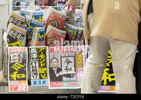 Tokyo, Japan. 01st Apr, 2019. Japanese newspapers feature news on Japanese Chief Cabinet Secretary Yoshihide Suga announcing the kanji ''Reiwa'' as the new name of the next Imperial era. The government announced ''Reiwa'' as new Imperial era name today, April 1st. The new era will start on May 1st when the Crown Prince Naruhito ascends the throne, after his father, Emperor Akihito, formally abdicates on April 30. Credit: Rodrigo Reyes Marin/AFLO/Alamy Live News - Stock Photo