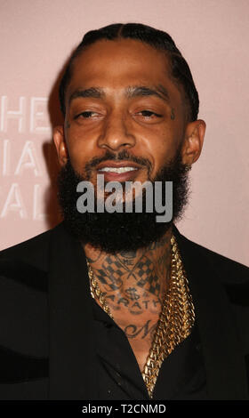 File. 31st Mar, 2019. Rapper NIPSEY HUSSLE (born Ermias Davidson Asghedom, Aug. 15, 1985 - March 31, 2019) was shot and killed outside his clothing company called the Marathon Store, in the Hyde Park neighborhood of Los Angeles, south of the Crenshaw area. PICTURED: September 13, 2018 - New York, New York, U.S. - Rapper NIPSEY HUSSLE attends Rihanna's 4th Annual Diamond Ball. Credit: Nancy Kaszerman/ZUMA Wire/Alamy Live News - Stock Photo