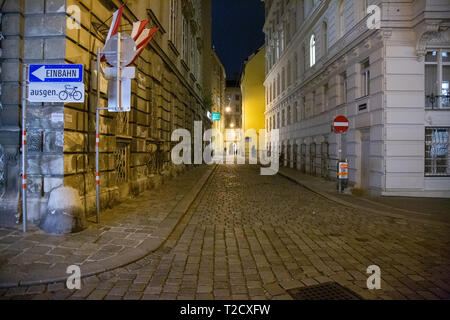 Palais Fürstenberg on a cobbled street corner showing Grünangergasse on the left and Domgasse on the right, at night time in Vienna, Austria - Stock Photo