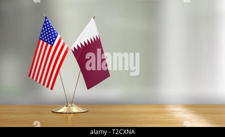 Flags pair on a desk over defocused background - Stock Photo