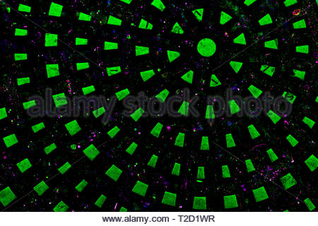 A radiating, explosive pattern background derived from a manhole cover. Copy space. - Stock Photo