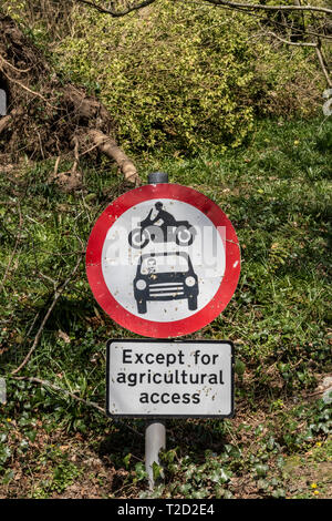 Sign post, no vehicles, vehicular access except agricultural access. - Stock Photo