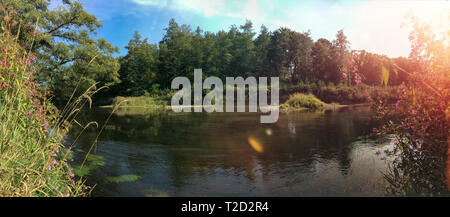 green landscape with bushes and trees. Bank of the river Ruhr. Oeventrop in North Rhine Westphalia, Germany. Wide view - Stock Photo