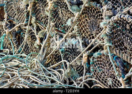 An abstract shot of crab pots or creels stacked up on the quayside of Arbroath harbour, Angus, Scotland. - Stock Photo