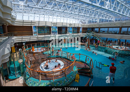 People enjoying the interior swimming pool on the cruise ship MSC Splendida - Stock Photo