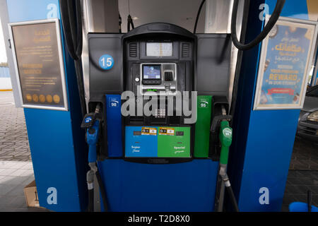 Nozzles on a fuel dispenser machine at a petrol station in the United Arab Emirates - Stock Photo