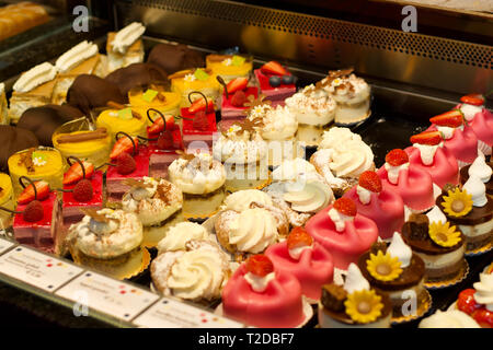 Colorful and tasty cakes on the counter - Stock Photo