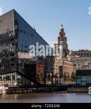 Historic Liverpool waterfront buildings reflected in modern glass office blocks - Stock Photo