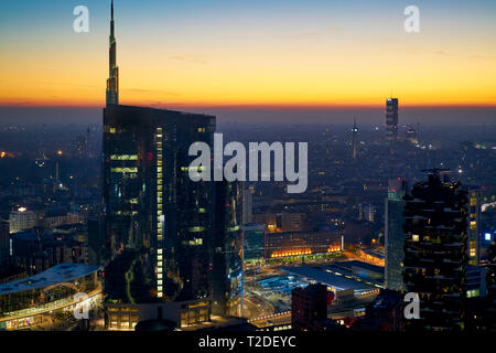 Aerial view of Porta Nuova central district at dusk. Porta Nuovais one of the mainbusiness districtsofMilan,Italyin terms of economy,. Named aft - Stock Photo