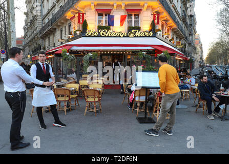 PARIS, FRANCE - March 30, 2019 : Cafe Le Champ de Mars is typical French cafe located near the Eiffel tower in Paris, France. - Stock Photo