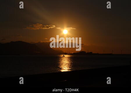 Sunset over the bay of Biscay at Getxo - Stock Photo