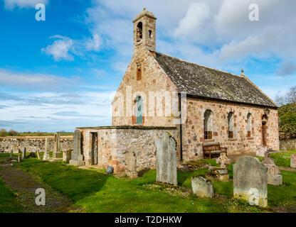 12th century Morham Parish Church and old graveyard with worn gravestones, East Lothian, Scotland, UK - Stock Photo