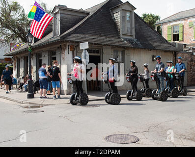 A Segway tour happening in front of Lafitte's Blacksmith Shop Bar, New Orleans, Louisiana. - Stock Photo